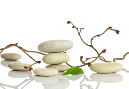 stack stones: Spa stones and green leaf, isolated on white background  Stock Photo