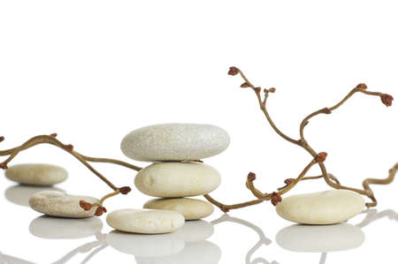 hazel branches: Spa stones and dry hazel branches, isolated on white background
