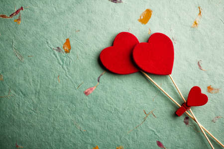 Old retro grungy background with decoration hearts. Stock Photo