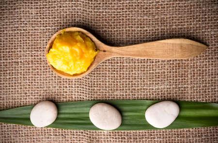 Mango body butter, spa stones, green leaf and orange. photo
