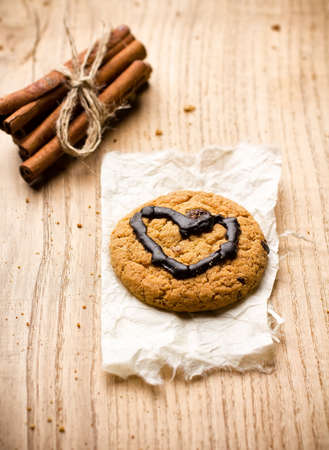 Oatmeal cookies with chocolate heart shape  photo
