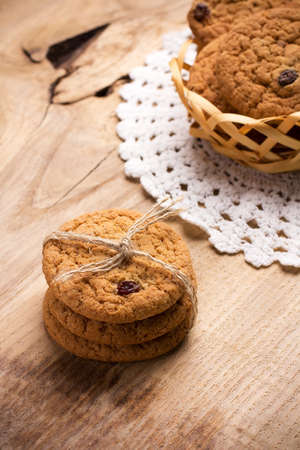 Oatmeal cookies on a wooden table, still life photo.  photo