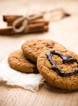 Oatmeal cookies with chocolate heart shape. photo