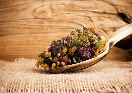 Dry herbal tea and the wooden spoon. Stock Photo - 18650220