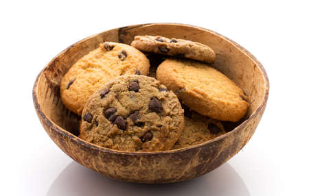 Oatmeal cookies with chocolate, coconut bowl. Ecological product. photo