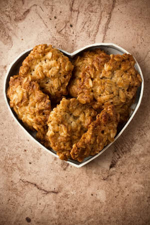 Oatmeal cookies heart-shaped box. photo