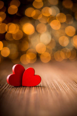 Hearts on a wooden table and background is a bokeh  Stockfoto