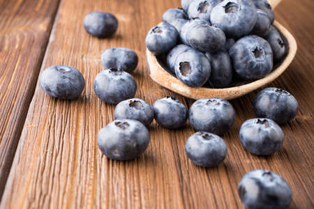 Blueberries on a wooden background  photo