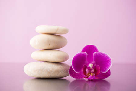 Spa stones pink orchid and pink background. photo