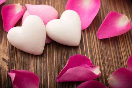 Rose petals and stone hearts  photo