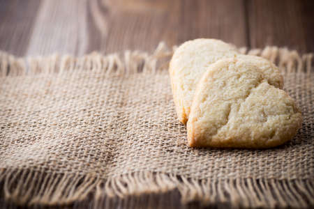 Heart of the cookies and the wooden background. photo