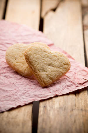 Heart of the cookie and wooden background. photo