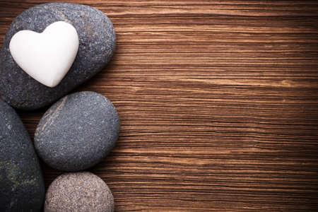 Spa stones in te wooden background  Stockfoto