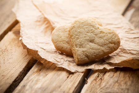 Heart of the cookie and wooden background  photo