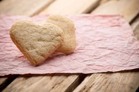 Heart of the cookie and wooden table. photo