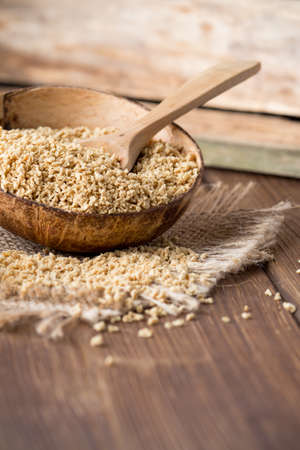 soja: Soy wooden bowl on a wooden surface, eco product. Stock Photo