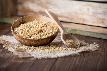 protein crops: Soy wooden bowl on a wooden surface, eco product. Stock Photo