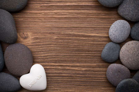 Spa stones in te wooden background. photo