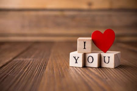 love message: Love message written in wooden blocks. Red heart.