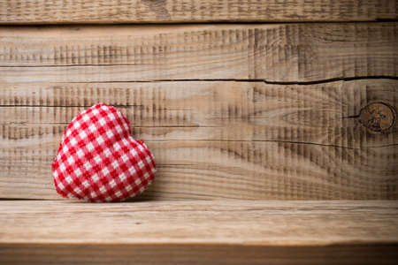 White wooden heart and wooden  background. photo