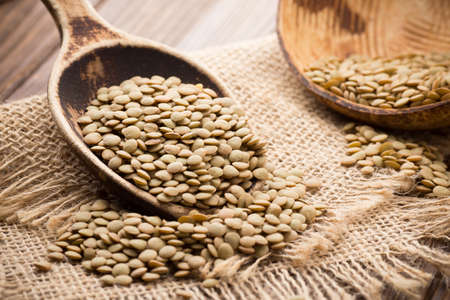 Lentils wooden spoon on wooden . Healthy food. photo