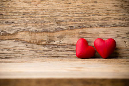 Red heart on the wooden  .