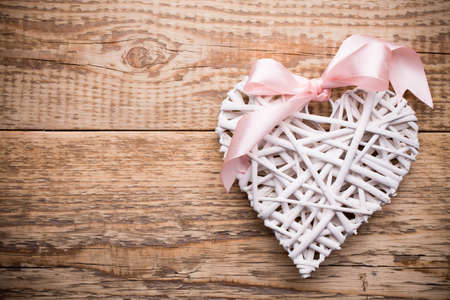 full willow: White heart and wooden  background. Stock Photo