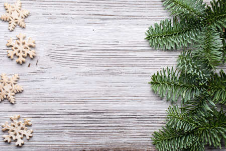 Christmas backgrounds. Christmas decor on the wooden background. photo
