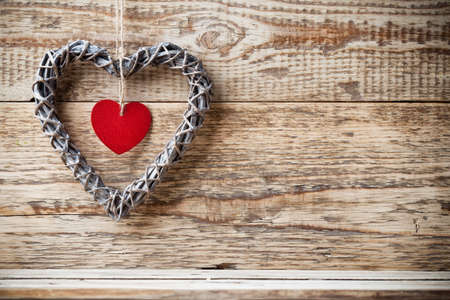 full willow: Pete wooden heart and wooden  background. Stock Photo