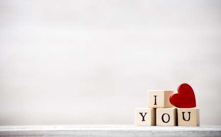love message: Love message written in wooden blocks. Stock Photo
