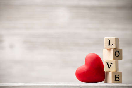 block: Love message written in wooden blocks. Stock Photo
