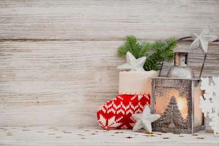 Lantern, Christmas decor, wooden background. Stock Photo