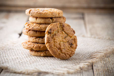 Oatmeal cookies with wooden background. Stock Photo