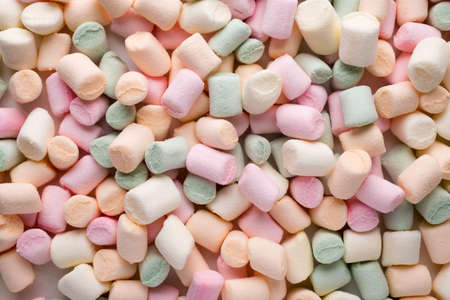 candy background: A pile of small colored puffy marshmallows.