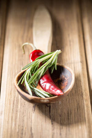basic food: Chili pepper on wooden background, basic food background. Stock Photo