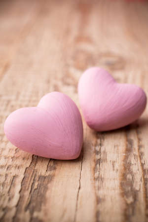 Pink heart on the wooden background. Provance still.
