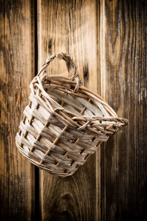 On the walls hang wooden basket with rye. Studio photo. photo