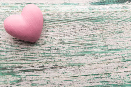 provencal: Pink heart on the wooden background. Provencal still. Stock Photo