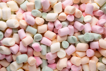 medium shot: A pile of small colored puffy marshmallows.