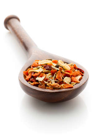 Spice mix a wooden spoon on a white background. photo