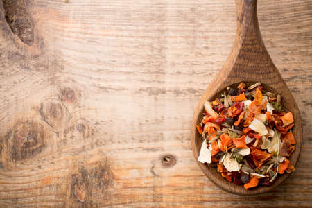 Spice mix a wooden spoon on a wooden background. photo
