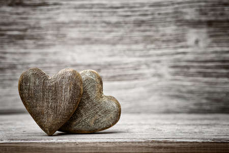 Heart on a wooden background. Vintage style. Reklamní fotografie - 31426595