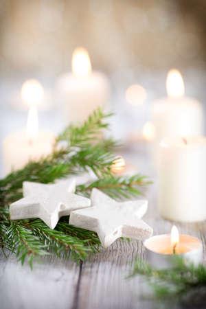 candle light: Christmas scene, candles with Christmas decor.