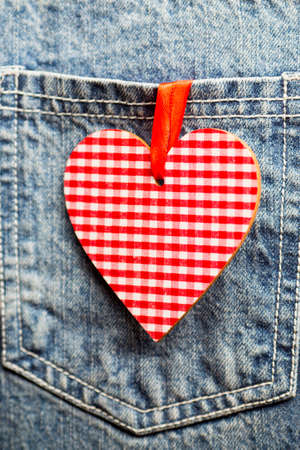 Blue jeans texture pocket and red heart. photo