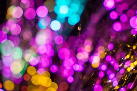 Colored defocused lights background. Abstract bokeh lights .