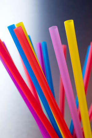 rainbow cocktail: Drinking straws. Multi-colored, kitchen accessories. Stock Photo