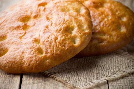 turkish bread: Fresh Turkish bread on a wooden background. Studio photography.