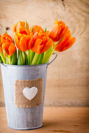 tulip: Tulips on a wooden surface.