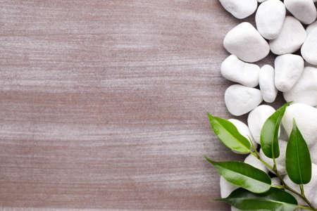 white pebble: White pebble stones frame and leafs Background. Stock Photo