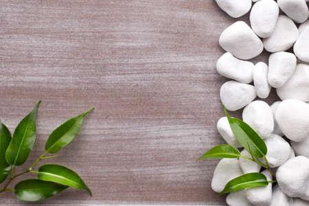 white pebble: White pebble stones frame and leafs Stock Photo